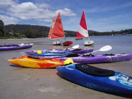 sailing dinghies and kayaks ready to launch into spring and summer